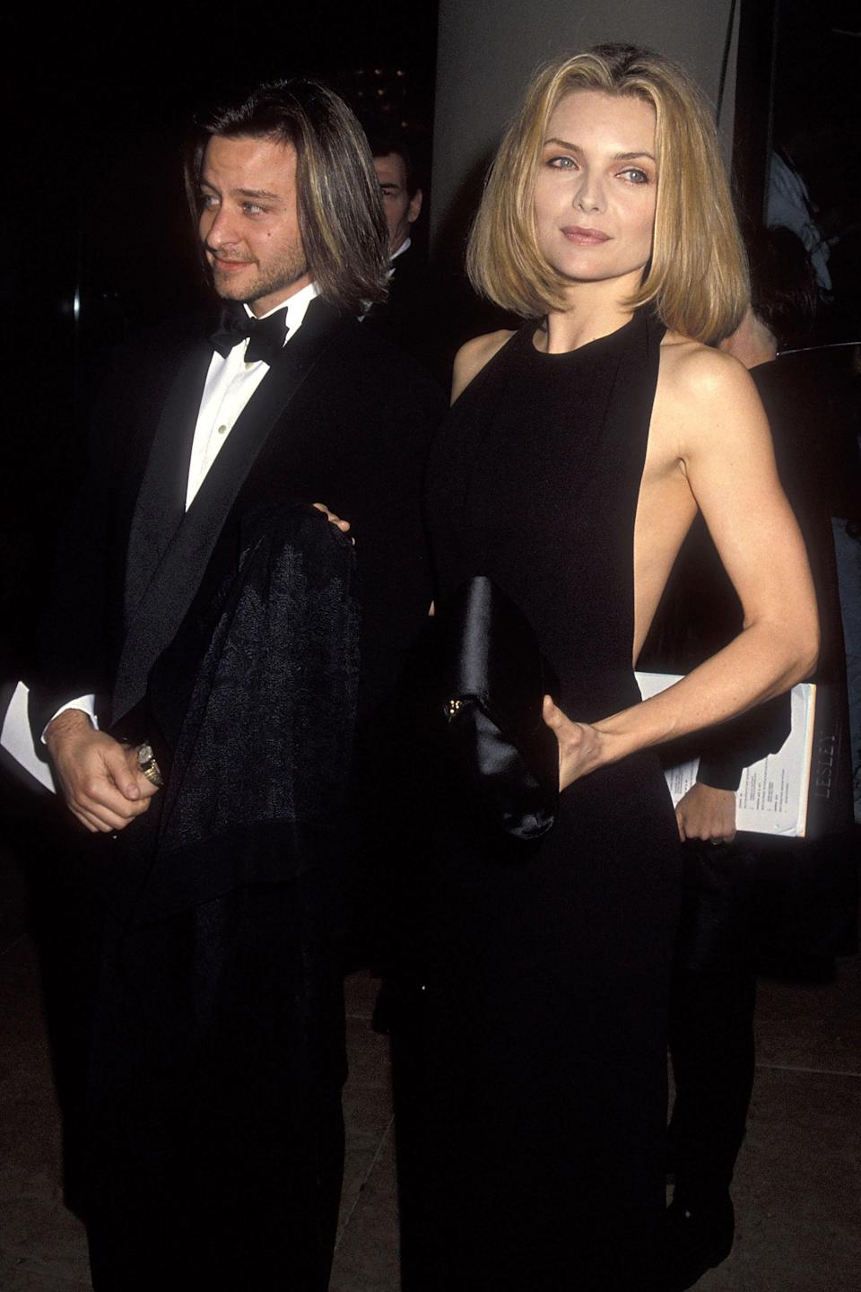 """<strong><h2>1992 </h2></strong><br>She may not have been able to beat Bette Midler for the Golden Globe, but Michelle Pfeiffer was no doubt the best-dressed nominee of the night.<br><br><em>Michelle Pfeiffer in a black gown. </em><span class=""""copyright"""">Photo: Ron Galella, Ltd./WireImage.</span>"""