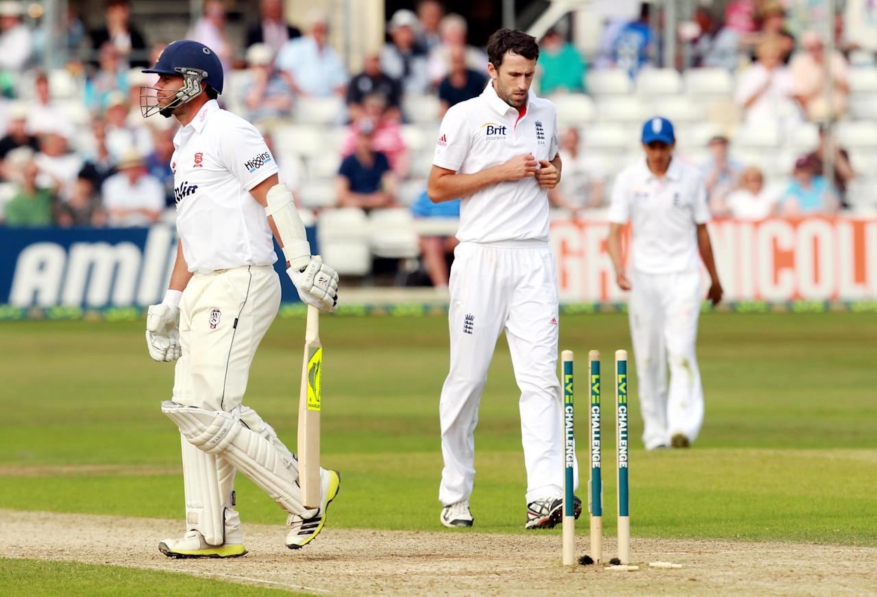 Essex batsman Mark Pettini walks off dejected after being bowled by England's Graham Onions during day two of the International Warm up match at The County Ground, Chelmsford.
