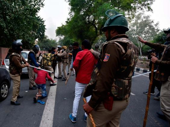 Police clash with demonstrators in New Delhi (STR/AFP via Getty Images)