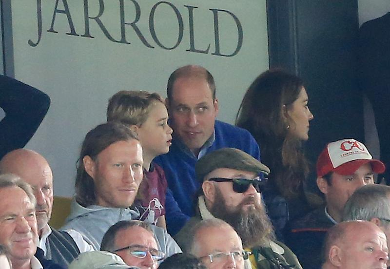 NORWICH, ENGLAND - OCTOBER 05: Prince George of Cambridge speaks to Prince William, Duke of Cambridge during the Premier League match between Norwich City and Aston Villa at Carrow Road on October 05, 2019 in Norwich, United Kingdom. (Photo by Stephen Pond/Getty Images)