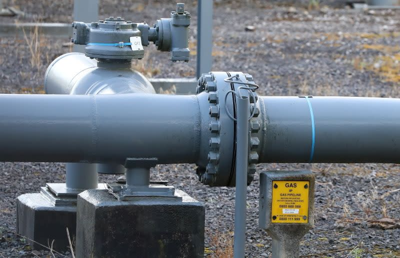 FILE PHOTO: Sections of gas pipeline are seen next to a disused gas holder in Manchester