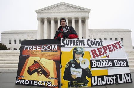 Alan Hoyle rallies in front of the U.S. Supreme Court in Washington, in this January 15, 2014 file photo. The U.S. Supreme Court on June 26, 2014 struck down a Massachusetts law that mandates a protective buffer zone around abortion clinics to allow patients unimpeded access. REUTERS/Yuri Gripas/Files