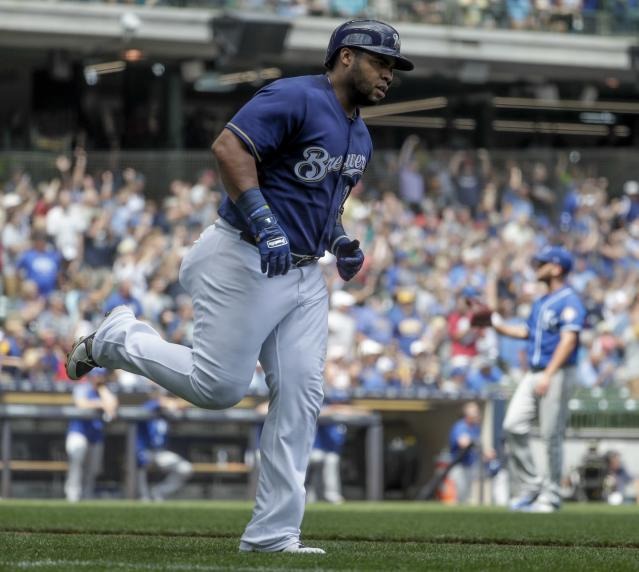 Milwaukee Brewers' Jesus Aguilar celebrates after hitting a home run during the sixth inning of a baseball game against the Kansas City Royals Wednesday, June 27, 2018, in Milwaukee. (AP Photo/Morry Gash)