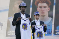 Golden State Warriors draft picks James Wiseman, left, and Nico Mannion pose for photos at a news conference in San Francisco, Thursday, Nov. 19, 2020. (AP Photo/Jeff Chiu)