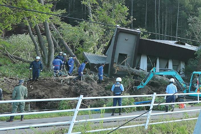 Police scrambled to rescue people trapped by landslides (AFP Photo/JIJI PRESS)