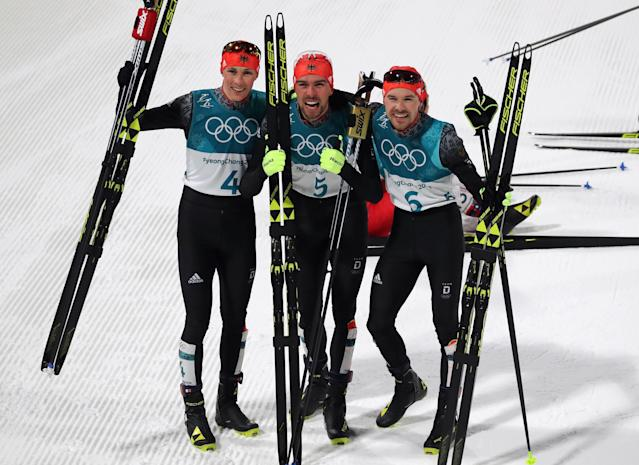 Nordic Combined Events - Pyeongchang 2018 Winter Olympics - Men's Individual 10 km Final - Alpensia Cross-Country Skiing Centre - Pyeongchang, South Korea - February 20, 2018 - Eric Frenzel of Germany, Johannes Rydzek of Germany and Fabian Riessle of Germany celebrate. REUTERS/Carlos Barria