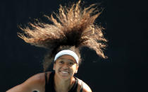 FILE - In this Jan. 18, 2020, file photo, Japan's Naomi Osaka serves during a practice session ahead of the Australian Open tennis tournament in Melbourne, Australia. Osaka has been selected by The Associated Press as the Female Athlete of the Year. (AP Photo/Lee Jin-man, File)