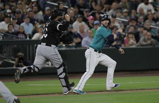Chicago White Sox catcher Omar Narvaez, left, runs down Seattle Mariners' Mitch Haniger between home and third base for an out during a baseball game, Friday, July 20, 2018, in Seattle. (AP Photo/Ted S. Warren)
