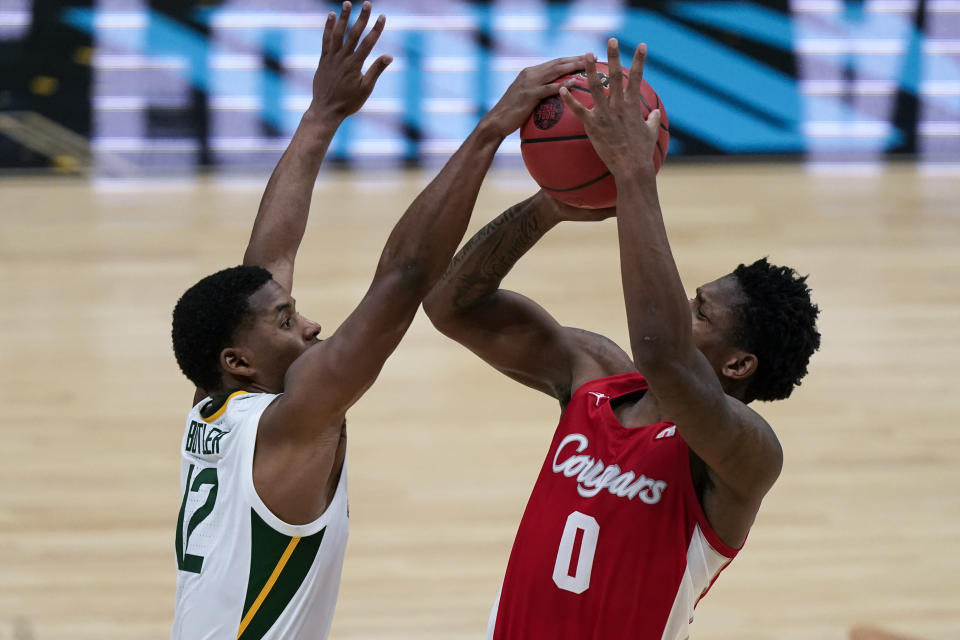 Houston guard Marcus Sasser (0) is fouled by Baylor guard Jared Butler (12) during the second half of a men's Final Four NCAA college basketball tournament semifinal game, Saturday, April 3, 2021, at Lucas Oil Stadium in Indianapolis. (AP Photo/Michael Conroy)