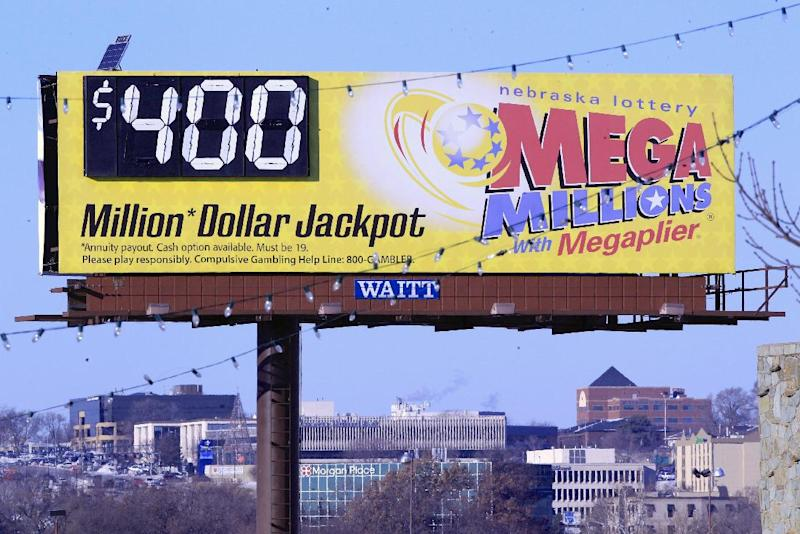 A billboard displays the estimated jackpot for the Mega Millions lottery Thursday, Dec. 12, 2013, in Omaha, Neb. The estimated jackpot of $400 million for Friday's Mega Millions drawing is the fifth largest ever and second largest in the game's history, trailing behind the $656 million jackpot in 2012. Officials say the revamped game helped create the latest jackpot, and they expect more to come in 2014. (AP Photo/Nati Harnik)