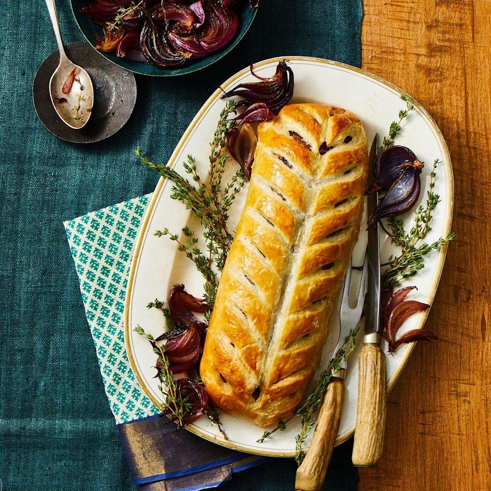 """<p>This hearty dish is sure to impress your partner this V-day — plus, it's actually much easier to make than it looks.</p><p><em><a href=""""https://www.goodhousekeeping.com/food-recipes/a34739368/beef-wellington-recipe/"""" rel=""""nofollow noopener"""" target=""""_blank"""" data-ylk=""""slk:Get the recipe for Beef Wellington »"""" class=""""link rapid-noclick-resp"""">Get the recipe for Beef Wellington »</a></em></p>"""
