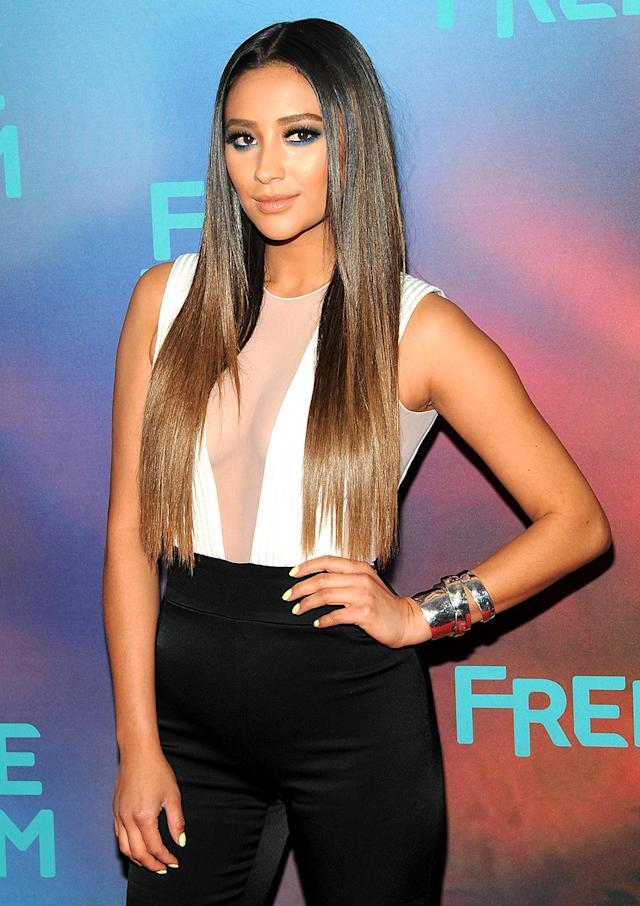 <p>The former <i>Pretty Little Liars</i> star is a fan of Kim Kardashian's style, so it's not surprising that she tried out the Cher hair look last month at an ABC event. (Photo: Desiree Navarro/WireImage) </p>