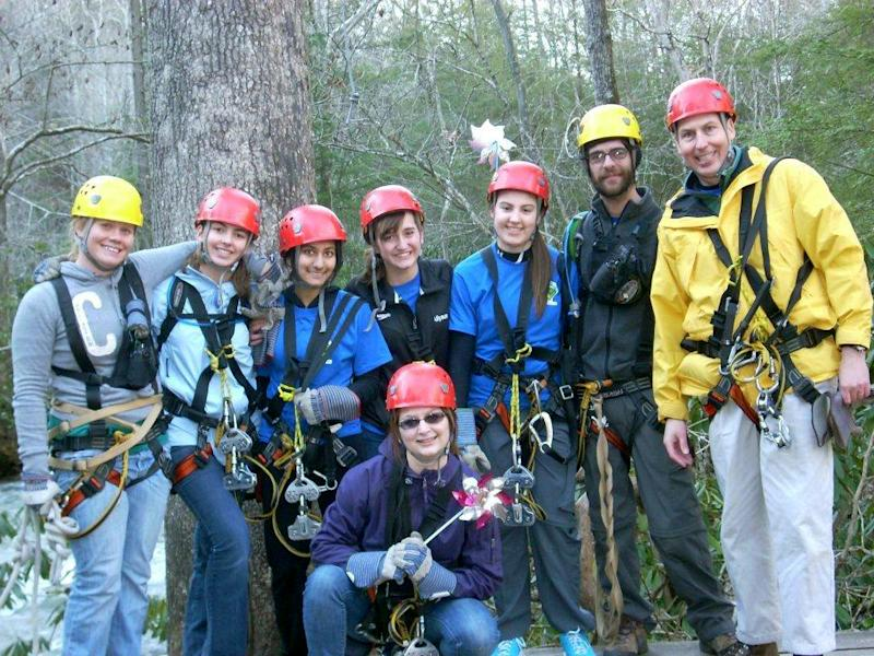 ADVANCE FOR MONDAY JULY 1, 2013 - This photo courtesy of the McGhee Family, members of Boy Scouts Venture Crew 1893 from Charleston, W.Va., are shown in a 2012 photo during a ziplining trip at Adventures on the Gorge in Fayetteville, W.Va. In the back, from left to right, are an unidentified guide, Virginia McGhee, Noor Malik, Ally Ugland, Perry McGhee, another unidentified guide, and John McGhee. In the front is Haley Breeden. For the first time, Venture crew members will be allowed to participate in the Boy Scouts' National Jamboree, which takes place in mid-July in southern West Virginia. (AP Photo/Courtesy of Kelly McGhee)