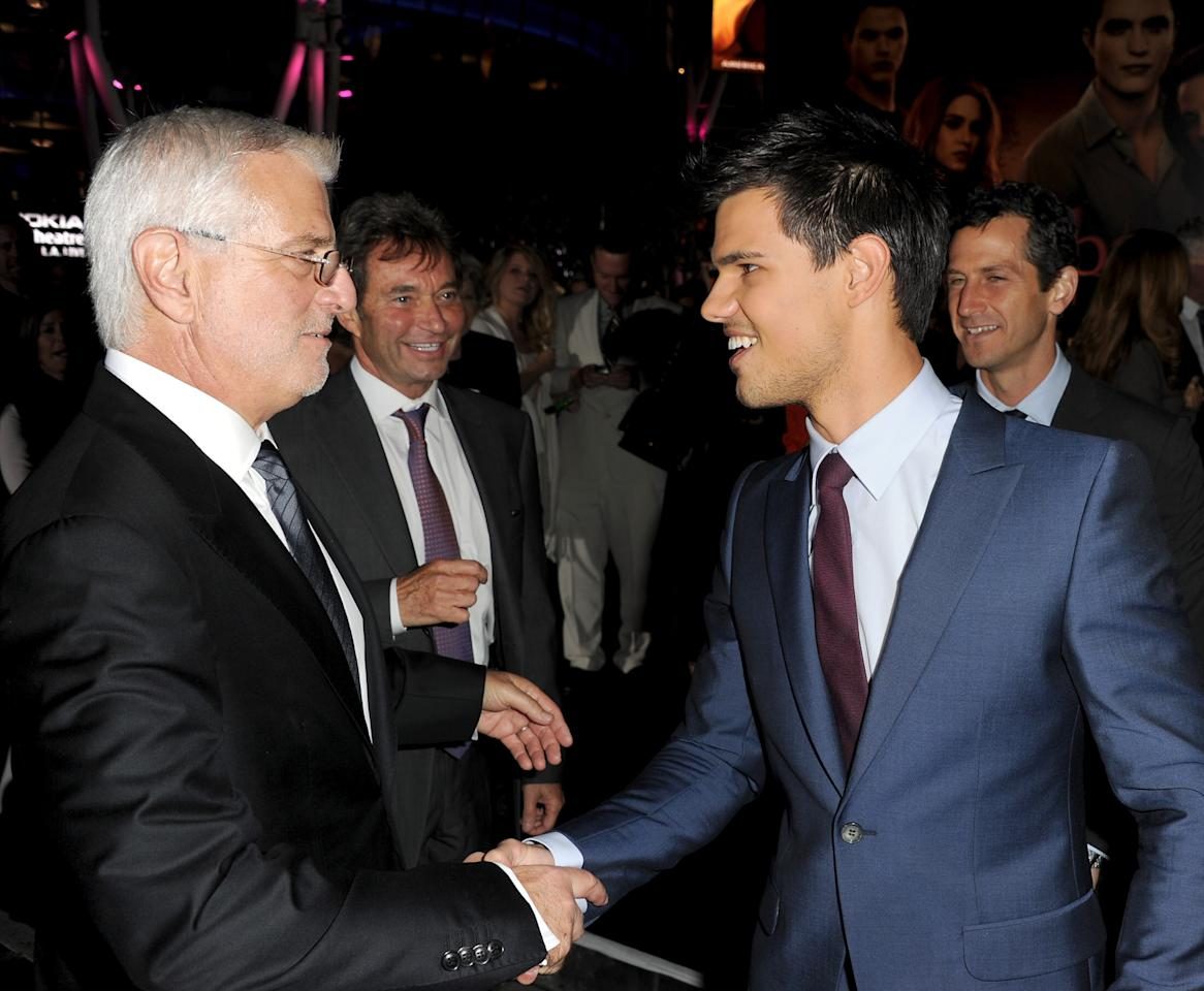 "LOS ANGELES, CA - NOVEMBER 14:  (L-R) Summit Entertainment Co-Chairman Rob Friedman, Summit Entertainment President & CEO Patrick Wachsberger, and actor Taylor Lautner arrive at the premiere of Summit Entertainment's ""The Twilight Saga: Breaking Dawn - Part 1"" at Nokia Theatre L.A. Live on November 14, 2011 in Los Angeles, California.  (Photo by Kevin Winter/Getty Images)"