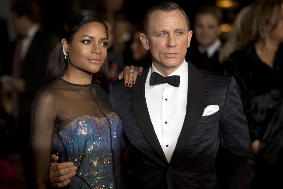 British actors Daniel Craig (R) and Naomie Harris (L) pose together as they arrive to attend the royal world premiere of the new James Bond film 'Skyfall' at the Royal Albert Hall in London on October 23, 2012. AFP PHOTO / LEON NEAL        (Photo credit should read LEON NEAL/AFP via Getty Images)
