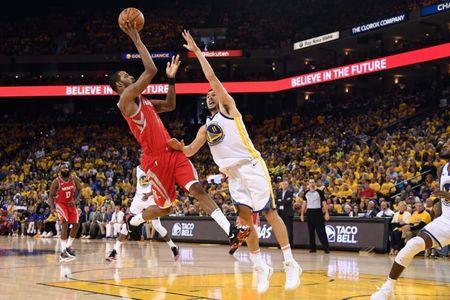 May 26, 2018; Oakland, CA, USA; Houston Rockets forward Trevor Ariza (1) shoots the ball against Golden State Warriors center JaVale McGee (1) during the second quarter in game six of the Western conference finals of the 2018 NBA Playoffs at Oracle Arena. Mandatory Credit: Kyle Terada-USA TODAY Sports