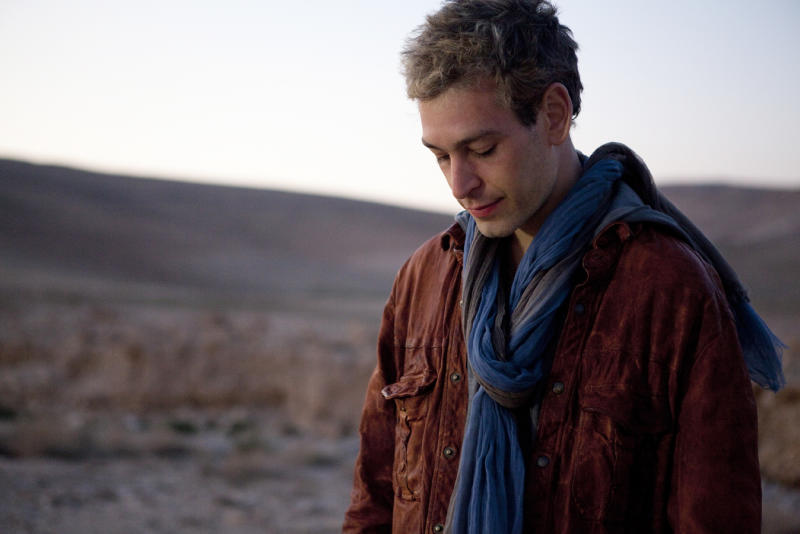 "This undated image released by Thirty Tigers shows Hassidic raggae musician Matisyahu. The 33-year-old Matisyahu is far from the one who lived for years in a modest apartment in Crown Heights, the Orthodox Jewish neighborhood in Brooklyn. He's moved his wife and three sons to Los Angeles, favors pastels over dark suits, ditched the yarmulke, changed his management team, and is self-releasing his music. This month, he releases his fourth studio CD, ""Spark Seeker,"" a fresh sound produced by Kool Kojak with reggae, hip-hop and electronica layered over Middle Eastern instruments and rhythms. (AP Photo/Thirty Tigers, Mark Squires)"