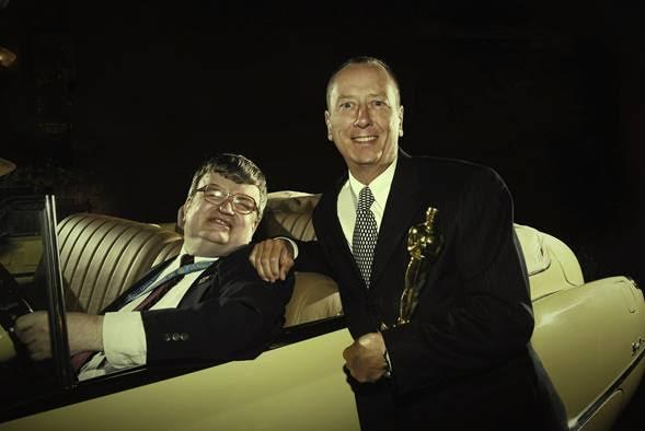 Oscar-winning <em>Rain Man</em> writer Barry Morrow posing with Kim Peek and his Oscar statuette. Peek is sitting in a 1949 Buick Roadmaster, identical to the one Tom Cruise and Dustin Hoffman drive in the movie. (Photo: Courtesy of Barry Morrow)