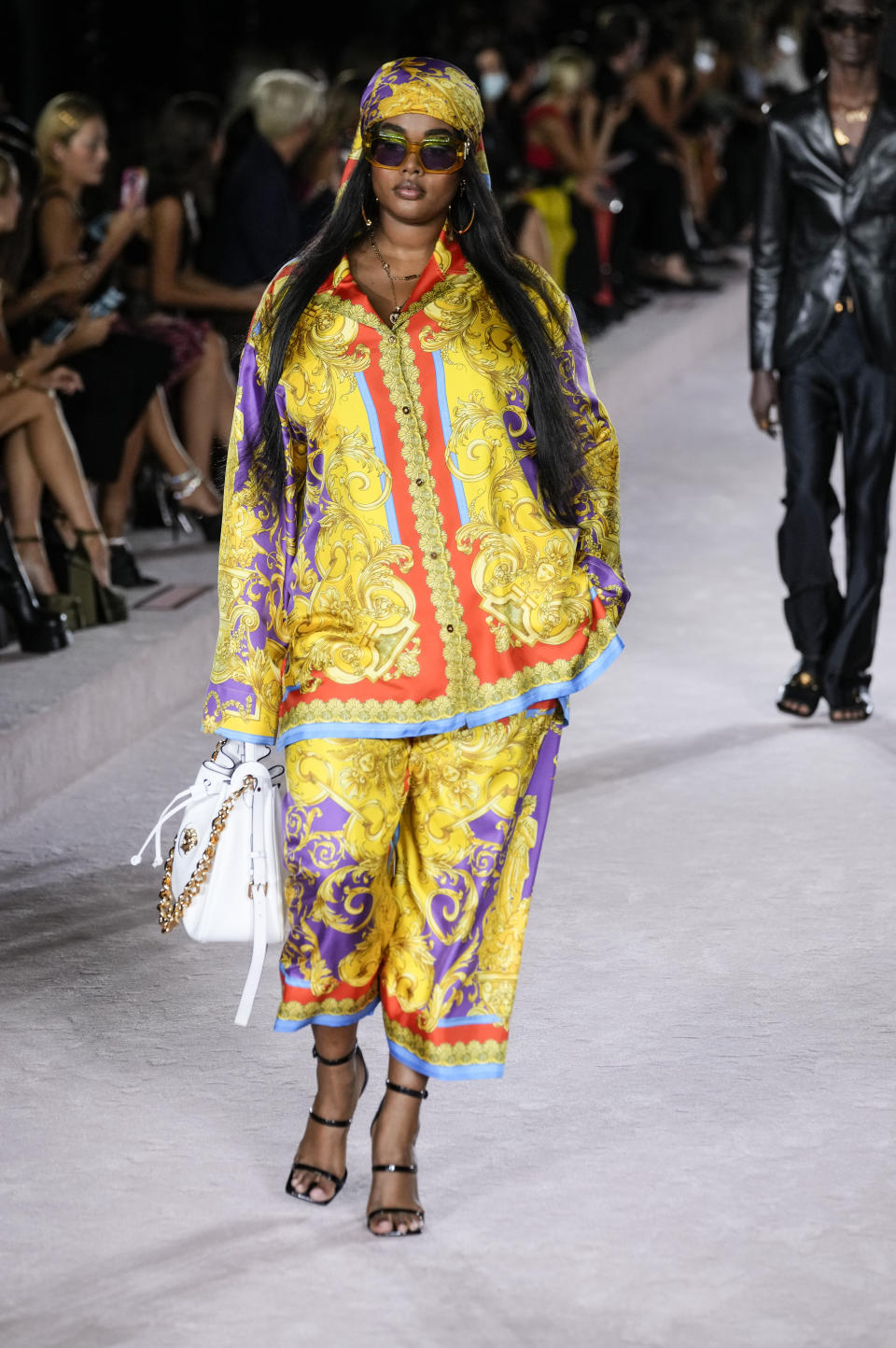 A model wears a creation for the Versace Spring Summer 2022 collection during Milan Fashion Week, in Milan, Italy, Friday, Sept. 24, 2021. (AP Photo/Luca Bruno)