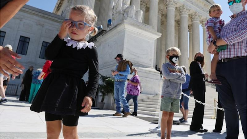 A girl dressed as RBG