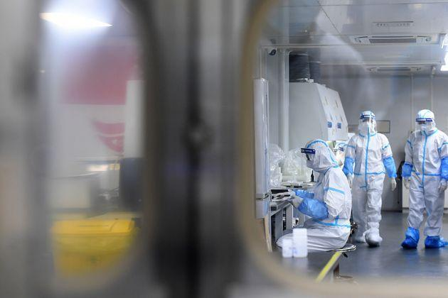 WUHAN, CHINA - AUGUST 05 2021: People in PPE work in the Huo-Yan (Fire Eye) Laboratory designed for high-capacity 2019-nCoV (SARS-CoV-2) detection in Wuhan in central China's Hubei province Thursday, Aug. 05, 2021. (Photo credit should read Feature China/Barcroft Media via Getty Images) (Photo: Barcroft Media via Getty Images)