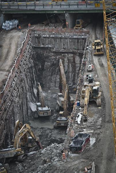 This photo taken on Thursday April 17, 2014, shows ongoing construction of a rail tunnel at the Hudson Yards redevelopment site on Manhattan's west side in New York. Amtrak is constructing an 800-foot-long concrete box inside the project to preserve space for a tunnel from Newark to New York City that would allow it to double rail capacity across the Hudson River. (AP Photo/Bebeto Matthews)