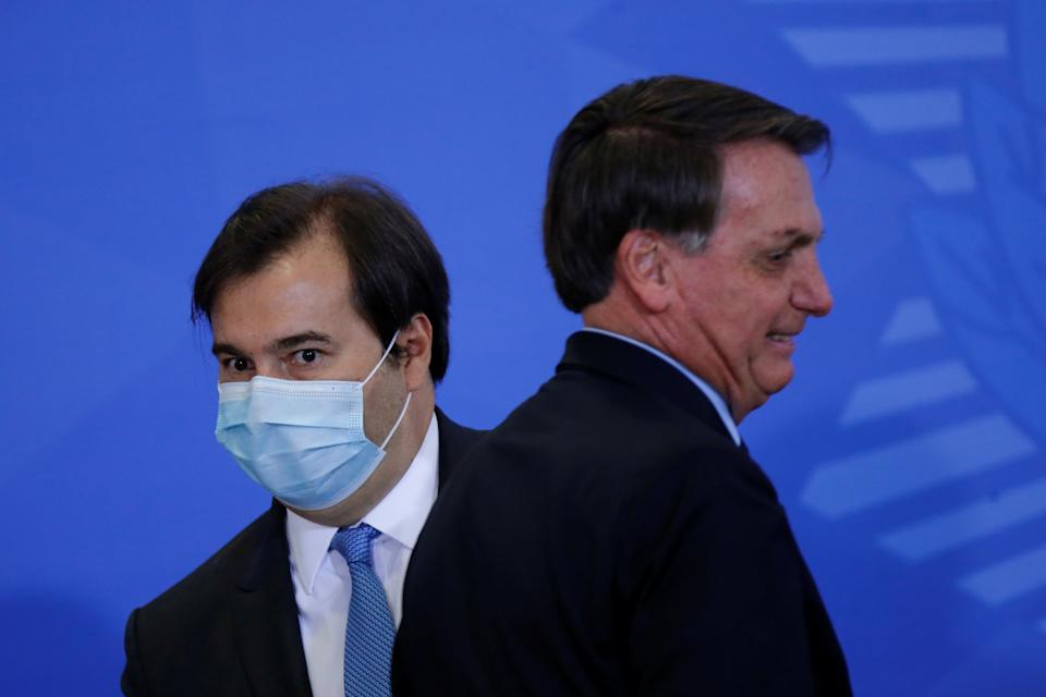 President of Brazil's Lower House Rodrigo Maia is seen next to Brazil's President Jair Bolsonaro during an inauguration ceremony of the new Communications Minister Fabio Faria (not pictured) at the Planalto Palace, in Brasilia, Brazil June 17, 2020. REUTERS/Adriano Machado