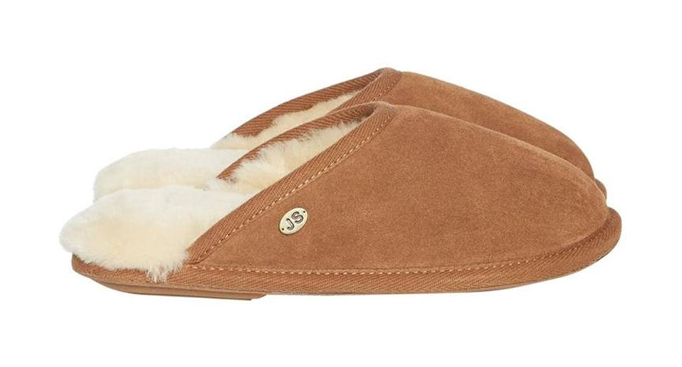 """Cosy slippers in winter are a must - this is the UK we live in, after all. Warm your mum's toes with this snug sheepskin pair, which, happily, are on sale. <a href=""""https://fave.co/31aivGn"""" rel=""""nofollow noopener"""" target=""""_blank"""" data-ylk=""""slk:Shop now."""" class=""""link rapid-noclick-resp""""><strong>Shop now.</strong></a>"""