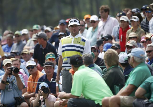 U.S. golfer Bubba Watson stands near his ball before making a shot on the 18th hole during the second round of the Masters golf tournament at the Augusta National Golf Club in Augusta, Georgia April 11, 2014. REUTERS/Mike Segar (UNITED STATES - Tags: SPORT GOLF)