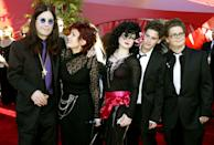 Musician Ozzy Osbourne (L) arrives with his family for the 54th annual Emmy Awards in Los Angeles September 22, 2002. From left are Ozzy, wife Sharon and children Kelly, Robert and Jack. REUTERS/Fred Prouser RG