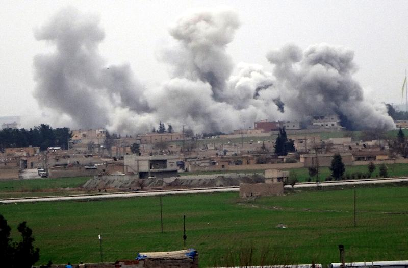 A photo from February 2016 shows smoke rising from the Tel Abyad neightbourhood during clashes between IS Group and People's Protection Units, which Russia and Turkey are currently discussing a possible ceasefire in Syria in December 2016