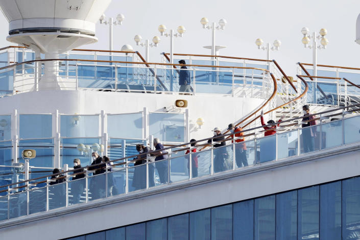 Passengers stand on the deck of the Diamond Princess cruise ship (AP)