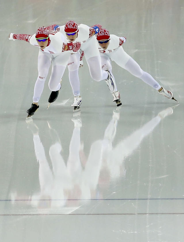 Team Russia's Yekaterina Lobysheva, left, Yulia Skokova, center and Olga Graf compete in the women's speedskating team pursuit quarterfinals at the Adler Arena Skating Center during the 2014 Winter Olympics in Sochi, Russia, Friday, Feb. 21, 2014. (AP Photo/Patrick Semansky)