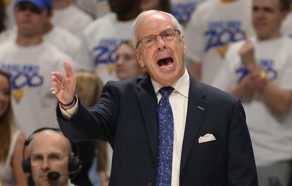 Roy Williams is retiring with a 903-264 record as a coach at Kansas and North Carolina.