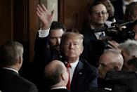 """President Donald Trump immediately claimed """"victory"""" after his acquittal in a historic impeachment, but Democrats said the outcome resulted from an unfair trial (AFP Photo/Olivier DOULIERY)"""