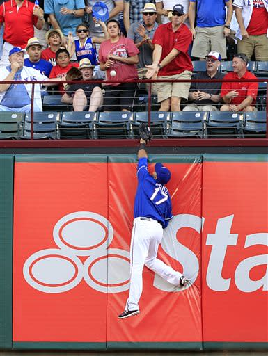 Texas Rangers right fielder Nelson Cruz can't get to Seattle Mariners Raul Ibanez's home run shot during the first inning of a baseball game Tuesday, July 2, 2013, in Arlington, Texas. (AP Photo/John F. Rhodes)