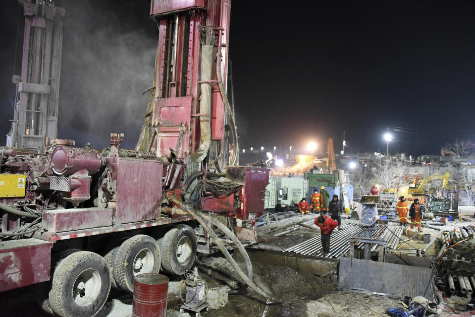 In this photo released by China's Xinhua News Agency, rescuers drill a new channel at the explosion site of a gold mine in Qixia City, east China's Shandong Province, Monday, Jan. 18, 2021. Chinese state media say 12 out of 22 workers trapped for a week by an explosion in the gold mine are alive, as hundreds of rescuers seek to bring them to safety. (Wang Kai/Xinhua via AP)