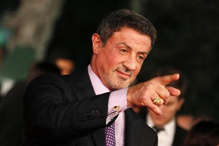 "Actor Sylvester Stallone poses during the red carpet of the movie ""Bullet to the Head"" at the Rome Film Festival"