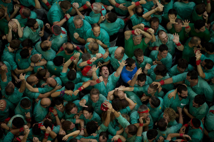 """<p>Members of the """"Castellers de Villafranca"""" react after completing their human tower during the 26th Human Tower Competition in Tarragona, Spain, Oct. 2, 2016. (AP Photo/Emilio Morenatti)</p>"""