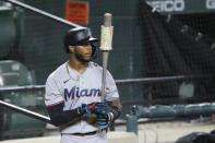 """FILE - Miami Marlins' Monte Harrison stands at the on deck circle during the third inning of a baseball game in Baltimore, in this Tuesday, Aug. 4, 2020, file photo. Marlins outfield prospect Monte Harrison says he surprised himself when he made his major league debut last year. """"I said I was not going to be that guy who gets called up to the big leagues and struggles mentally,"""" Harrison said. """"And then when I got to the big leagues, I struggled mentally. That's very humbling."""" (AP Photo/Julio Cortez, File)"""