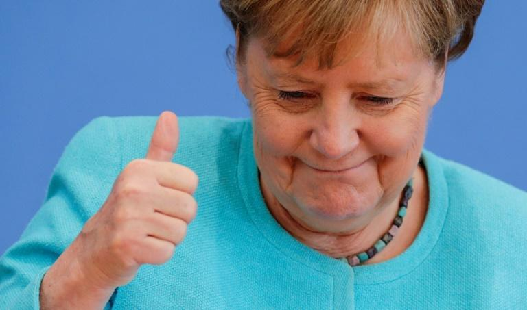 Angela Merkel will become the first German chancellor to step down entirely by choice (AFP/HANNIBAL HANSCHKE)