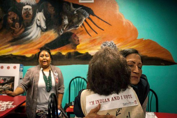 PHOTO: New Mexico congressional candidate Deb Haaland embraces a supporter during her visit to the Albuquerque Indian Center for the Native Vote Celebration in Albuquerque, N.M. on election night, Nov. 6, 2018. (Juan Antonio Labreche/AP, FILE)