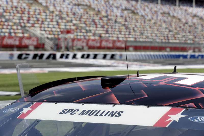 U.S Army Spc. Brandon S. Mullins name is displayed on the windshield of driver Corey LaJoie's car prior to a NASCAR Cup Series auto race at Charlotte Motor Speedway Sunday, May 24, 2020, in Concord, N.C. In honor of Memorial Day drivers will carry the name of a fallen military member on their cars. (AP Photo/Gerry Broome)