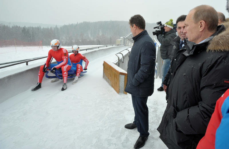 Russian Prime Minister and presidential candidate Vladimir Putin, right, and Deputy Prime Minister Dmitry Kozak, center, watch  Russian national luge team training at the sports center in Paramonovo, outside Moscow,  Russia, Thursday, Feb. 16, 2012.(AP Photo/RIA Novosti, Alexei Nikolsky, Government Press Service)