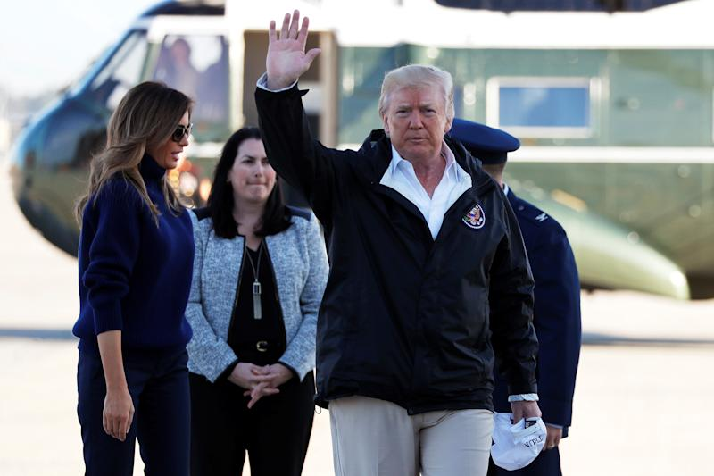 U.S. President Donald Trump waves to reporters as he and first lady Melania Trump arrive to board Air Force One for travel to Puerto Rico, to survey hurricane damage, from Joint Base Andrews, Maryland, U.S. October 3, 2017. (Jonathan Ernst / Reuters)