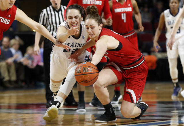 Maine's Blanca Millan, left, and Hartford's Darby Lee battle for the ball in the first half in the America East Conference women's basketball championship, Friday, March 9, 2018, in Bangor, Maine. (AP Photo/Robert F. Bukaty)
