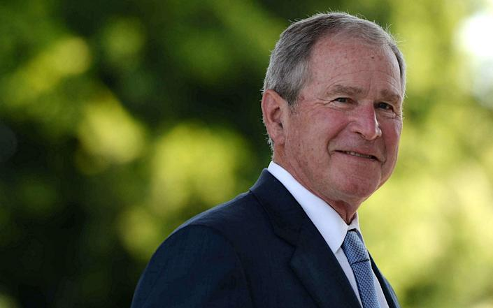 George Bush left office in 2009 - GETTY IMAGES