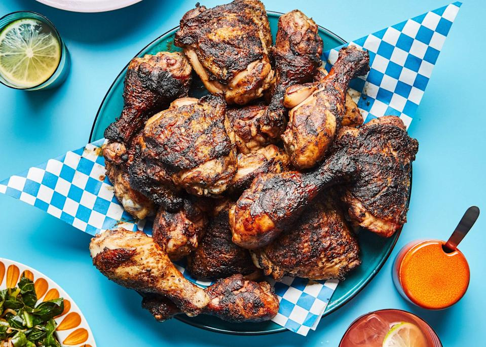 "A little Jamaican rum in the marinade makes this grilled chicken from chef Sarah Kirnon even more flavorful. <a href=""https://www.epicurious.com/recipes/food/views/miss-ollies-grilled-jerk-chicken?mbid=synd_yahoo_rss"" rel=""nofollow noopener"" target=""_blank"" data-ylk=""slk:See recipe."" class=""link rapid-noclick-resp"">See recipe.</a>"