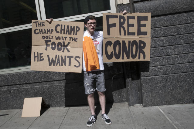 A fan of former UFC champion Conor McGregor shows his support outside Brooklyn Supreme court on June 14, 2018, in New York. (AP Photo/Mary Altaffer)