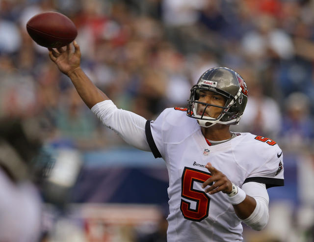 Tampa Bay Buccaneers quarterback Josh Freeman (5) throws a pass in the second half of an NFL football game against the New England Patriots Sunday, Sept. 22, 2013, in Foxborough, Mass. (AP Photo/Stephan Savoia)
